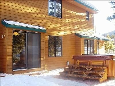 arctic spas hot tub next to a cedar house