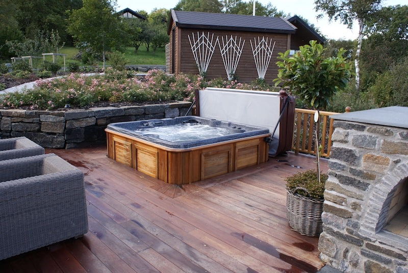 arctic spas hot tub sunk in deck garden