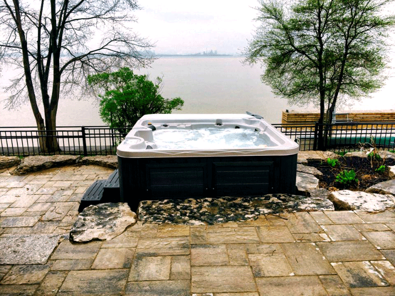 Arctic Spas Hot tub in the backyard overlook the lake